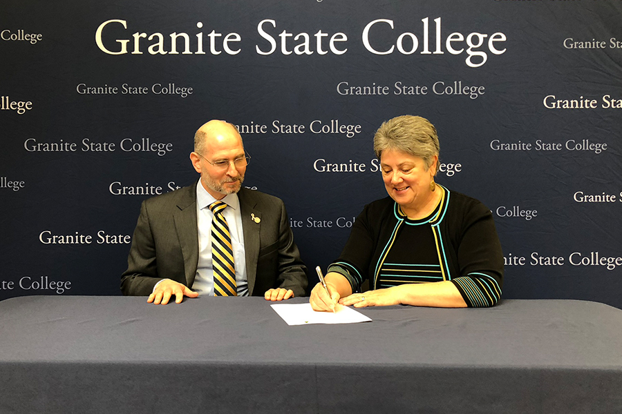 Granite State College signs partnership agreement with NH Retail Association.