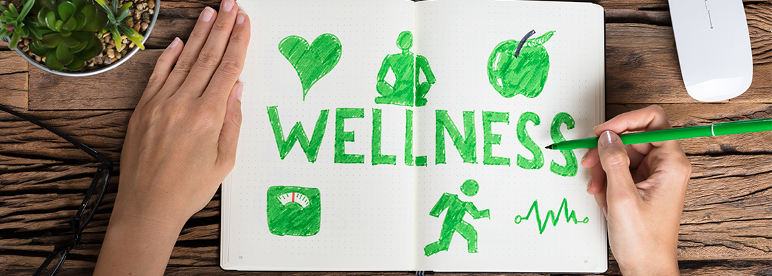 Person drawing out a wellness plan